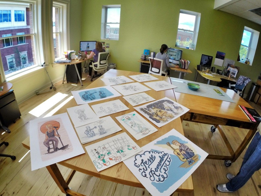 Sketches spread out on table
