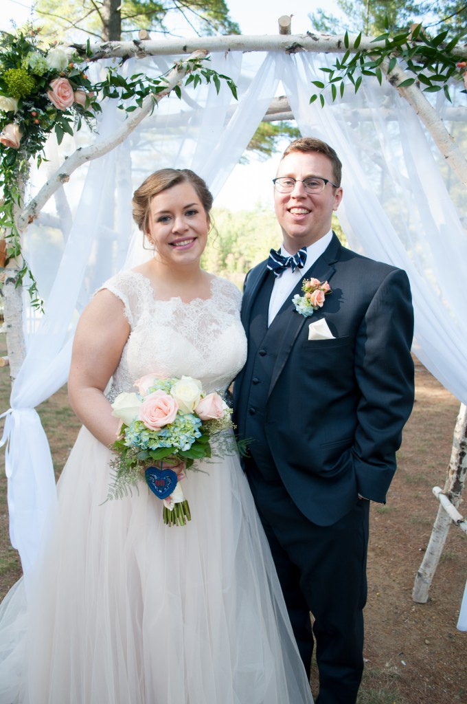 The happy couple (note the handcrafted birch arch behind us!)