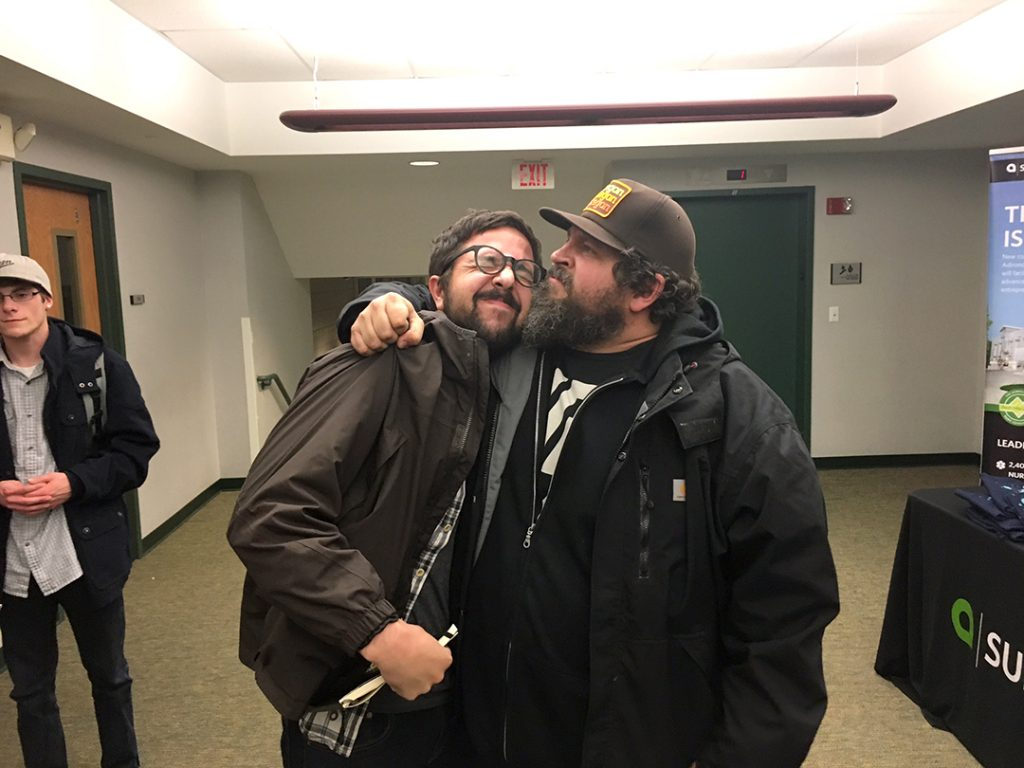 Draplin puts Rob in a headlock.