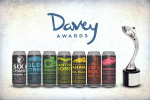 The family of Mean Max craft beer cans and the silver Davey Award their label design won