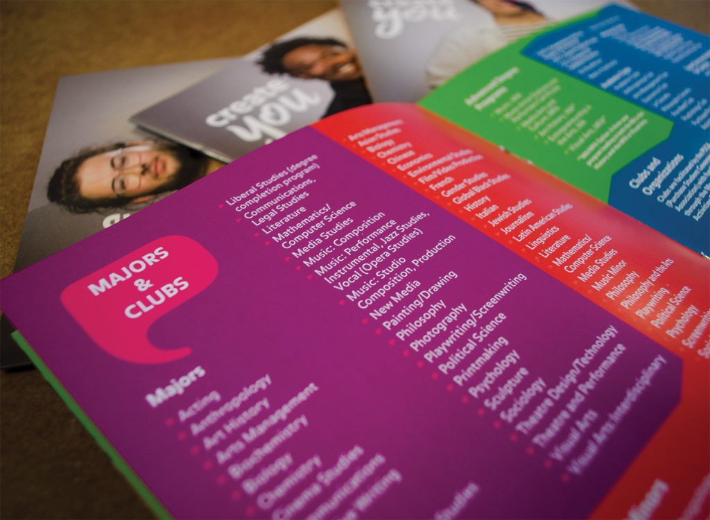 Bright colored brochures open on a table.