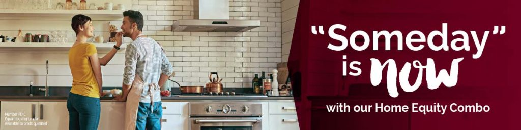 "A man and a woman stand in a kitchen, he wears an apron while she romantically places a bite of something in his mouth. To the right of the image it reads, ""Someday is now"" as a lead in to an ad for home equity loans."