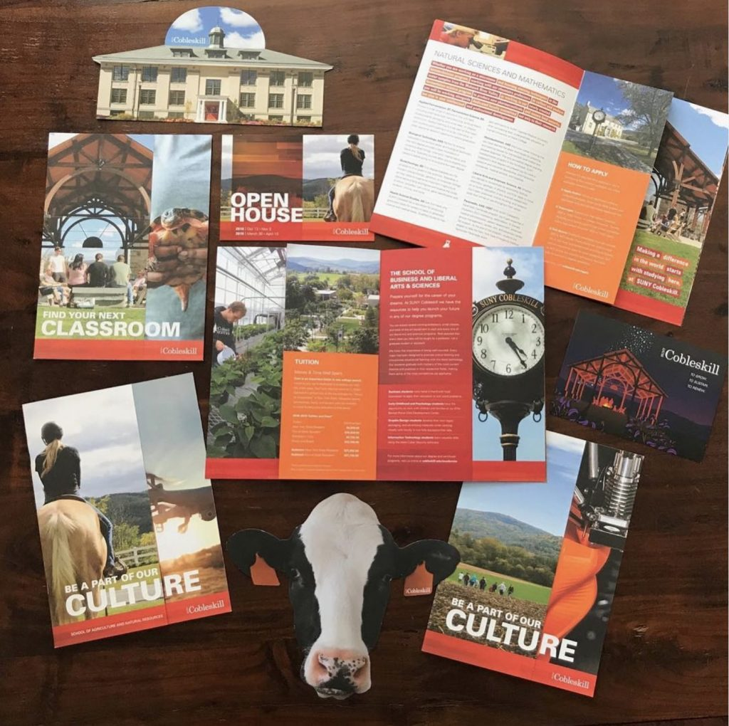 An assortment of brochures and custom cut outs for SUNY Cobleskill.