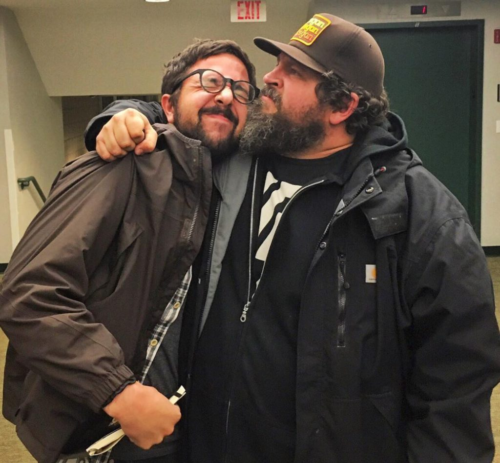 Aaron Draplin pulls Rob into a tight hug.