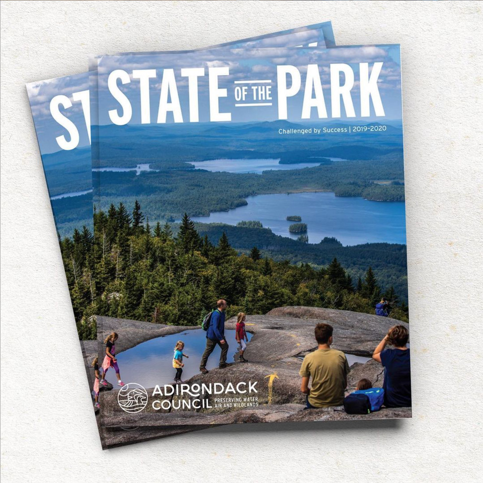 A publication called The State of The Park featuring a view of the Adirondacks.